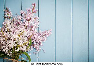Bouquet of lilac on the old blue wooden background