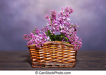 Bouquet of lilacs in a basket