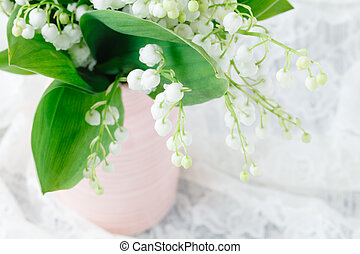 Bouquet of lilies of the valley on a grunge wooden  background