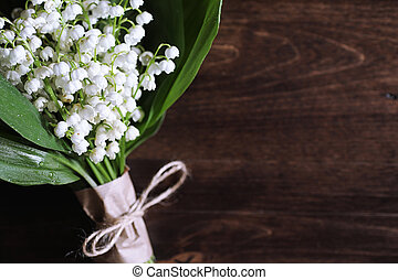Bouquet of lilies of the valley on a table