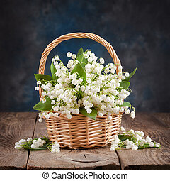 Bouquet of lilies of the valley on the table