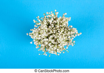 bouquet of lily of the valley on a blue background top view
