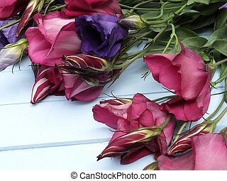 Magenta Lisianthus - Bouquet of Magenta Lisianthus laying on...