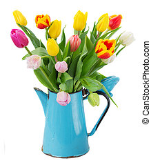 bouquet of multicolored tulip flowers in blue pot