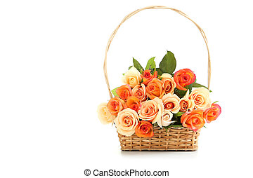 Bouquet of orange roses in basket isolated on white