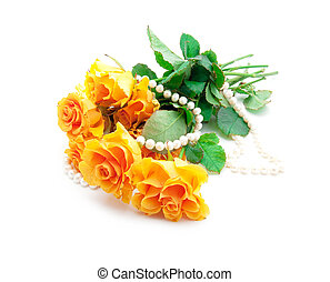 Bouquet of orange roses with a pearl necklace