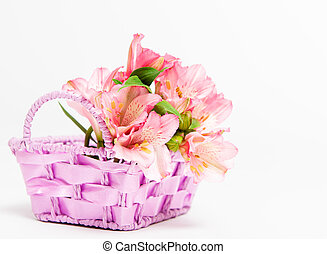 bouquet of pink alstroemeria in basket