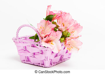 bouquet of pink flowers alstroemeria in basket