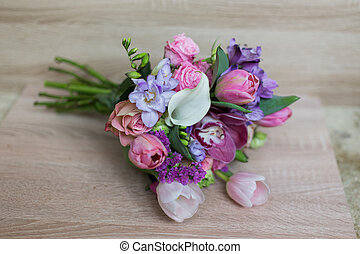 bouquet of pink flowers on a light background Rustic