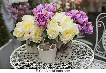 bouquet of pink peonies in vase on table
