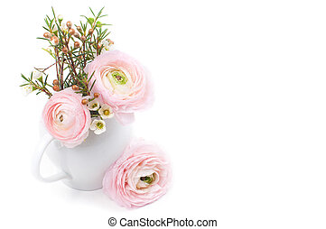 Bouquet of pink ranunculus in a ceramic jug on a white ...
