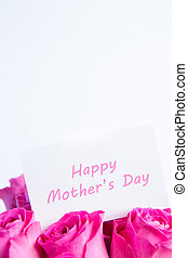 Bouquet of pink roses with happy mothers day card in pink
