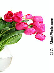 Bouquet of pink tulips in a glass vase.