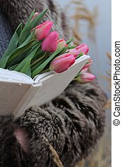 bouquet of pink tulips in hands
