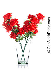 bouquet of plastic red roses in glass jar
