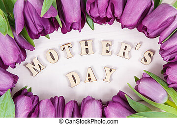 Bouquet of purple tulips with inscription mother's day on boards