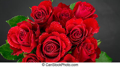 Bouquet of red beautiful roses on a black background