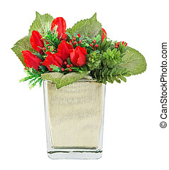 Bouquet of red rose and holly in glass vase