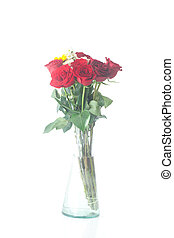 bouquet of red roses and sunflower in a vase