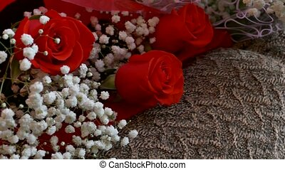 bouquet of red roses lying on chair in the room