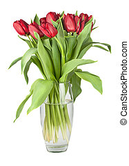 Bouquet of red tulips in a glass vase