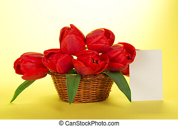 Bouquet of red tulips in basket