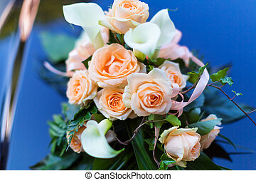 Bouquet of rose flowers on the wedding car - Macro view of...