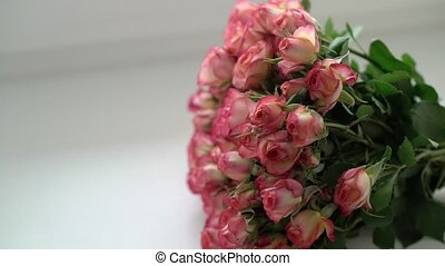 Bouquet of rose flowers with white ribbon