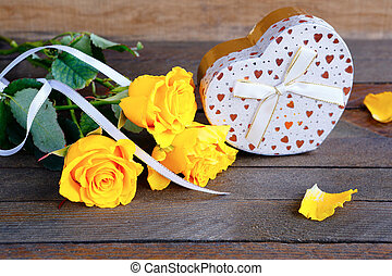bouquet of roses and a gift, valentine's day