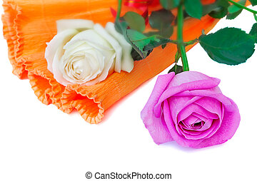 Bouquet of roses in a beautiful package on a white background.