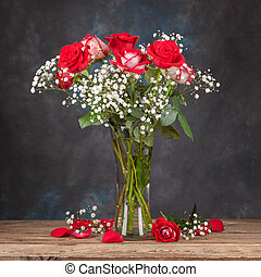 Bouquet of roses in a vase on the table