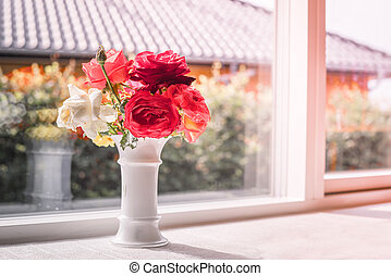Bouquet of roses in a window