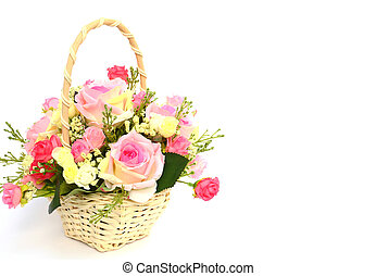 Bouquet of roses in white basket with space for text