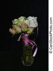 Bouquet of roses on a black background.