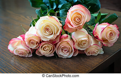 Bouquet of roses on the table surface.