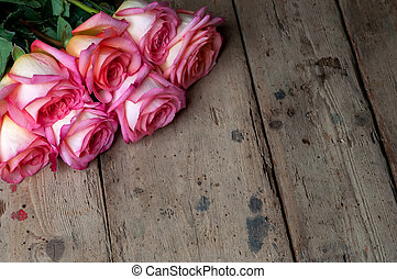 Bouquet of roses on wooden background.