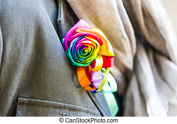 bouquet of roses with a thousand colors for everyone's rights, pinned on the jacket, the pride of a community