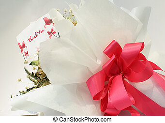 bouquet of  roses with thank you card on a white background