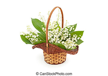 Bouquet of spring flowers in basket.