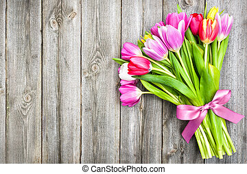 spring tulips on old wooden background