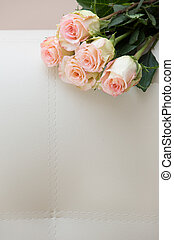 Bouquet of tea roses on a white sofa