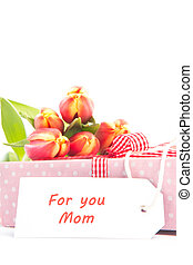 Bouquet of tulips on a gift with a card for a mother