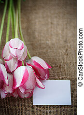 bouquet of tulips on an old table