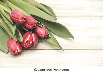 Bouquet of tulips on wooden background