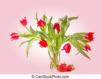 Bouquet of tulips with fresh strawberries.