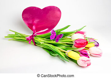 Bouquet of tulips with pink heart isolated on white background