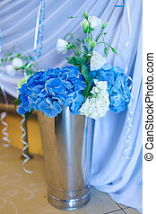 Bouquet of white and blue flower in metal vase