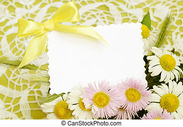 Bouquet of white and pink daisies with a card