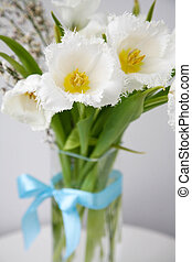 Bouquet of white fringed tulips with blue satin bow
