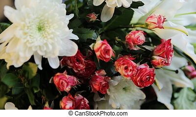 Bouquet of white lilies and red roses in a store.